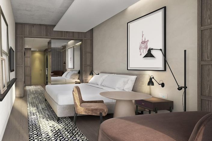 "Billing itself as an urban resort, this sleek newcomer on Leicester Square seeks to create a boutique feel on a massive scale. (With 350 rooms! Six dining and drinking outlets! A ballroom with a capacity of 864 guests!) Designed by <a href=""https://www.architecturaldigest.com/story/yabu-pushelberg-salone-del-mobile?mbid=synd_yahoo_rss"" rel=""nofollow noopener"" target=""_blank"" data-ylk=""slk:Yabu Pushelberg"" class=""link rapid-noclick-resp"">Yabu Pushelberg</a>—masters of minimalism with a luxe touch—it's sure to become a destination for locals as well as out-of-towners. <em>Opening in March 2021;</em> <a href=""https://www.thelondoner.com/"" rel=""nofollow noopener"" target=""_blank"" data-ylk=""slk:thelondoner.com"" class=""link rapid-noclick-resp""><em>thelondoner.com</em></a>"