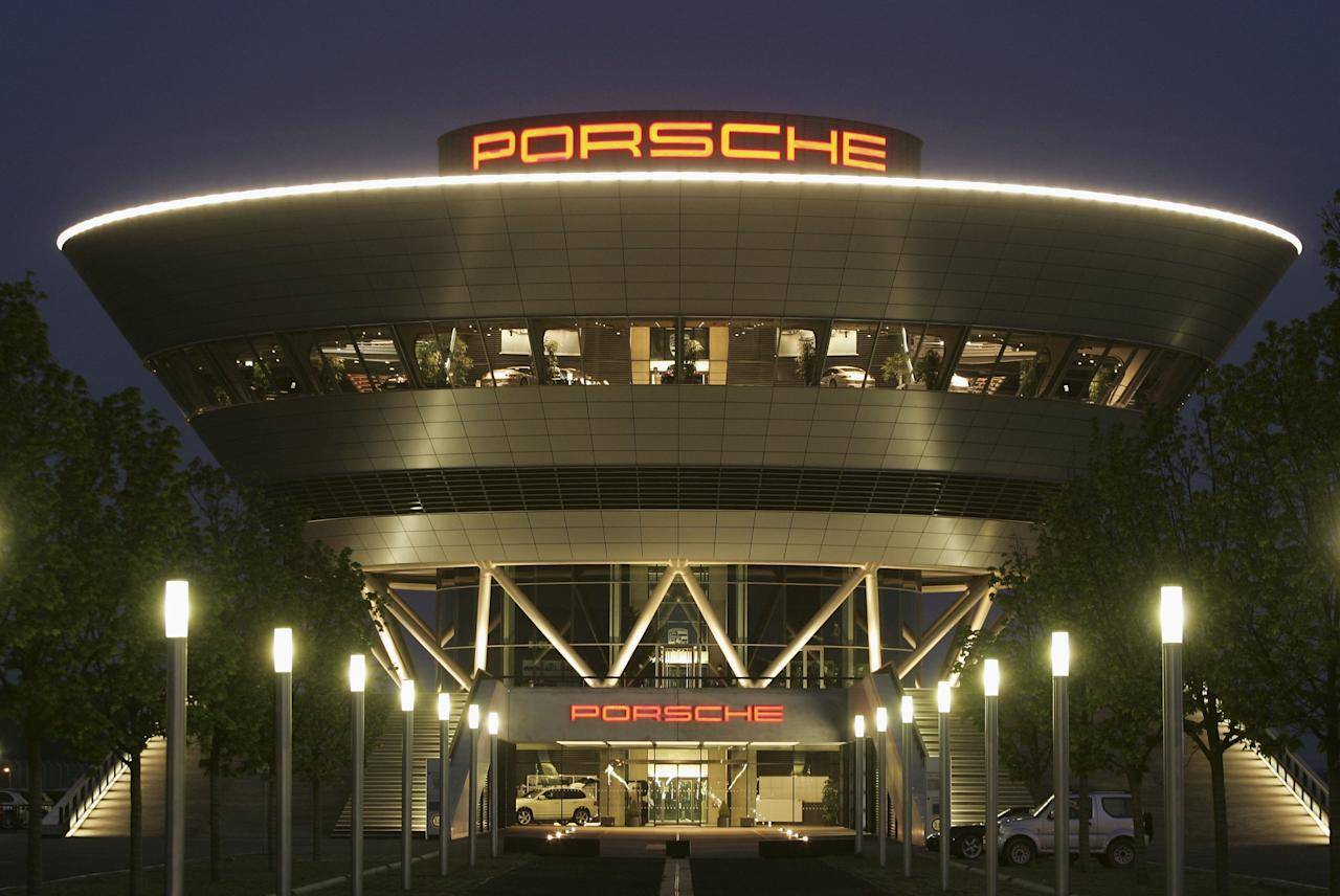 LEIPZIG, GERMANY - MAY 8: The inverted conical building of German car maker Porsche's customer center stands illuminated May 8, 2006 at the company's factory in Leipzig, Germany. Porsche produces its Cayenne SUV car at the futuristic, high-tech plant.    (Photo by Sean Gallup/Getty Images)