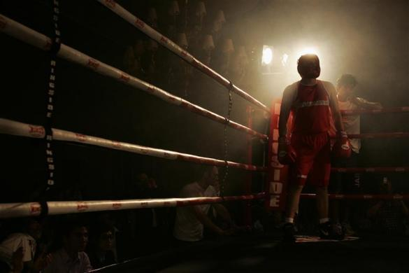 Will 'The Gunner' Sirret from Interactive Brokers takes part in a boxing fight at a five-star hotel in Hong Kong November 28, 2007.