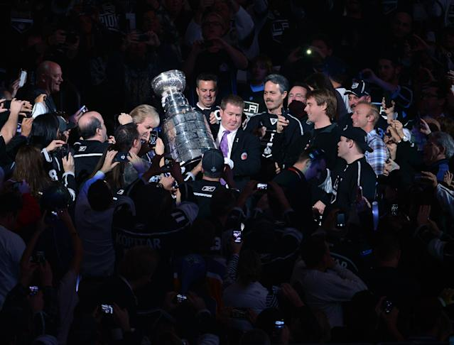LOS ANGELES, CA - JANUARY 19: Mike Bolt and Phil Pritchard of the Hockey Hall of Fame escort the Stanley Cup through the stands to the ice before the NHL season opening game between the Chicago Blackhawks and the Los Angeles Kings at Staples Center on January 19, 2013 in Los Angeles, California. (Photo by Harry How/Getty Images)