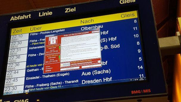 PHOTO: A window announcing the encryption of data including a requirement to pay appears on an electronic timetable display at the railway station in Chemnitz, eastern Germany, May 12, 2017. (P. Goetzelt/AFP/Getty Images)