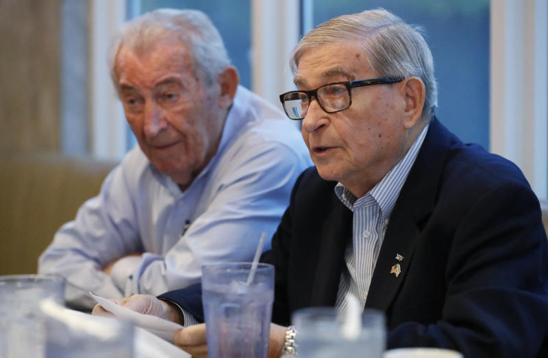 In this, Monday, Oct. 7, 2019 photo, David Mermelstein, right, President of Miami-Dade Holocaust Survivors (and Vice President of the Holocaust Survivors Foundation USA (HSF), speaks during an interview with The Associated Press along with David Schaecter, rear, President of HSF, in Aventura, Fla. Aging Holocaust survivors are trying to recover insurance benefits that were never honored by Nazi-era companies, which could be worth billions of dollars. The companies have demanded original paperwork, such as death certificates, that were not available after World War II. The survivors want to take insurance companies to court in the U.S. to recover the money, but it would take an act of Congress to allow it. (AP Photo/Wilfredo Lee)