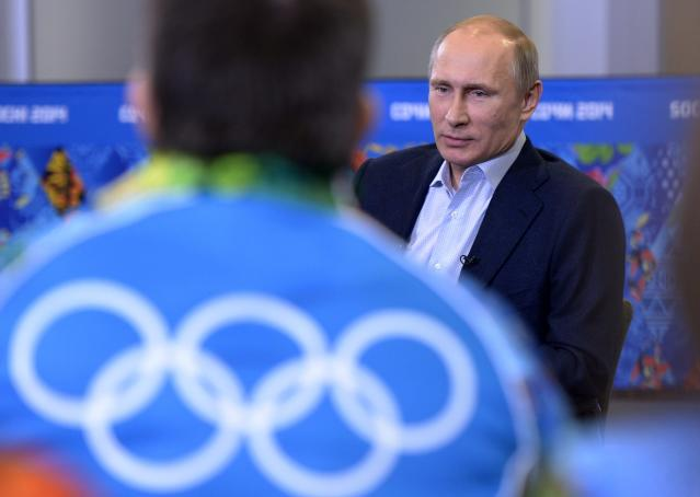 """Russian President Vladimir Putin speaks at his meeting with Olympic volunteers in the Black Sea resort of Sochi, Russia, Friday, Jan. 17, 2014. Putin says gays should feel welcome at the upcoming Winter Olympic Games in Sochi, but they must """"leave the children in peace."""" Putin told volunteers Friday that gays visiting Sochi """"can feel calm and at ease,"""" and vowed that there would be no discrimination at the games. But he emphasized that, according to a law banning homosexual """"propaganda"""" among minors, gays cannot express their views on gay rights issues to anyone underage. (AP Photo/RIA-Novosti, Alexei Nikolsky, Presidential Press Service)"""