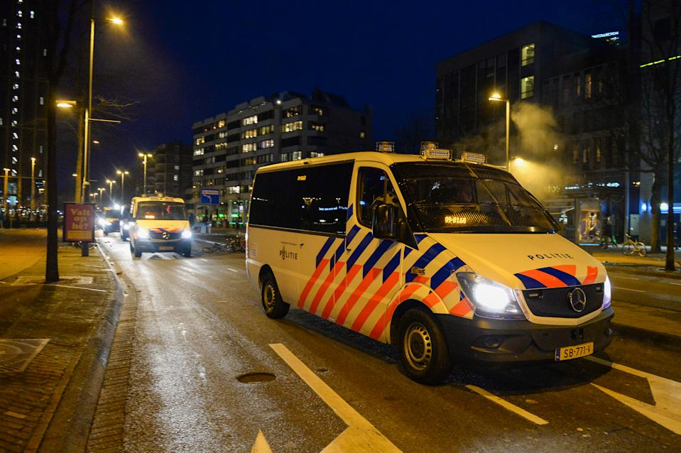 EINDHOVEN, NETHERLANDS - JANUARY 24: Police are seen in the city centre near Eindhoven Central Station on January 24, 2021 in Eindhoven, Netherlands after a forbidden protest against the coronavirus measures turned into riots. Police cleared the area in and around Central Staition after rioters looted a supermarket and set fire to a car. (Photo by Joris Verwijst/BSR Agency/Getty Images)