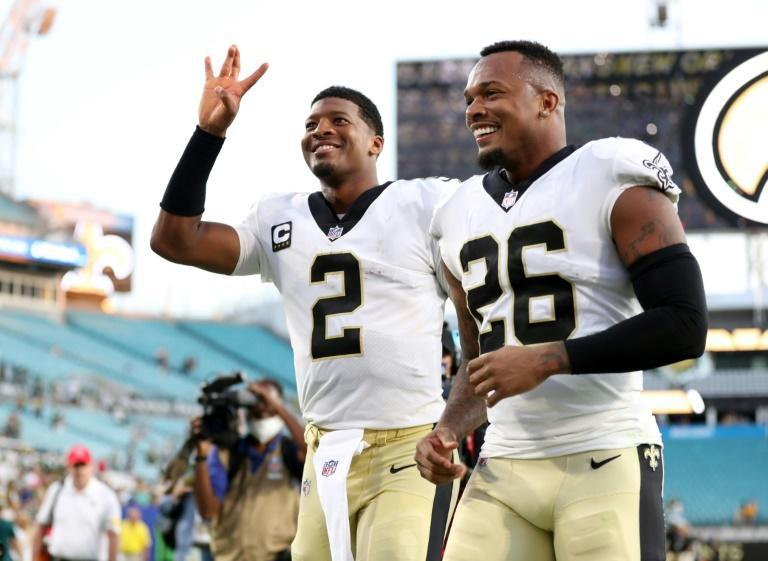 Quarterback Jameis Winston and New Orleans teammate P.J. Williams celebrate the Saints' NFL victory over the Green Bay Packers (AFP/James Gilbert)