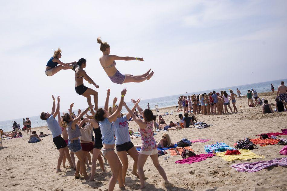 British students practise cheerleading performances on Salou beach during the second day of the Saloufest in Salou, Spain.