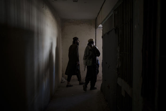 Taliban fighters walks inside an abandoned area of the Pul-e-Charkhi prison in Kabul, Afghanistan, Monday, Sept. 13, 2021. When the Taliban took control of a northern Afghan city of Pul-e-Kumri the operator of the only women's shelter ran away, abandoning 20 women in it. When the Taliban arrived at the shelter the women were given two choices: Return to their abusive families, or go with the Taliban, With nowhere to put the women, the Taliban took them to the abandoned women's section of Afghanistan's notorious Pul-e-Charkhi prison. (AP Photo/Felipe Dana)