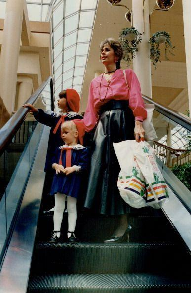 <p>The choice to wear heels while shopping seems misguided, but the idea to match the two daughters in <em>Madeline</em>-inspired outfits is genius.</p>
