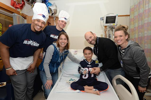 BOSTON, MA - MARCH 12: New England Patriot's Derek Rivers (L) and Ryan Izzo takes a picture with Liam and family at Boston Children's Hospital March 12, 2019 in Boston, Massachusetts. (Photo by Darren McCollester/Getty Images for Boston Children's Hospital) *** Local Caption *** Ryan Izzo;Derek Rivers