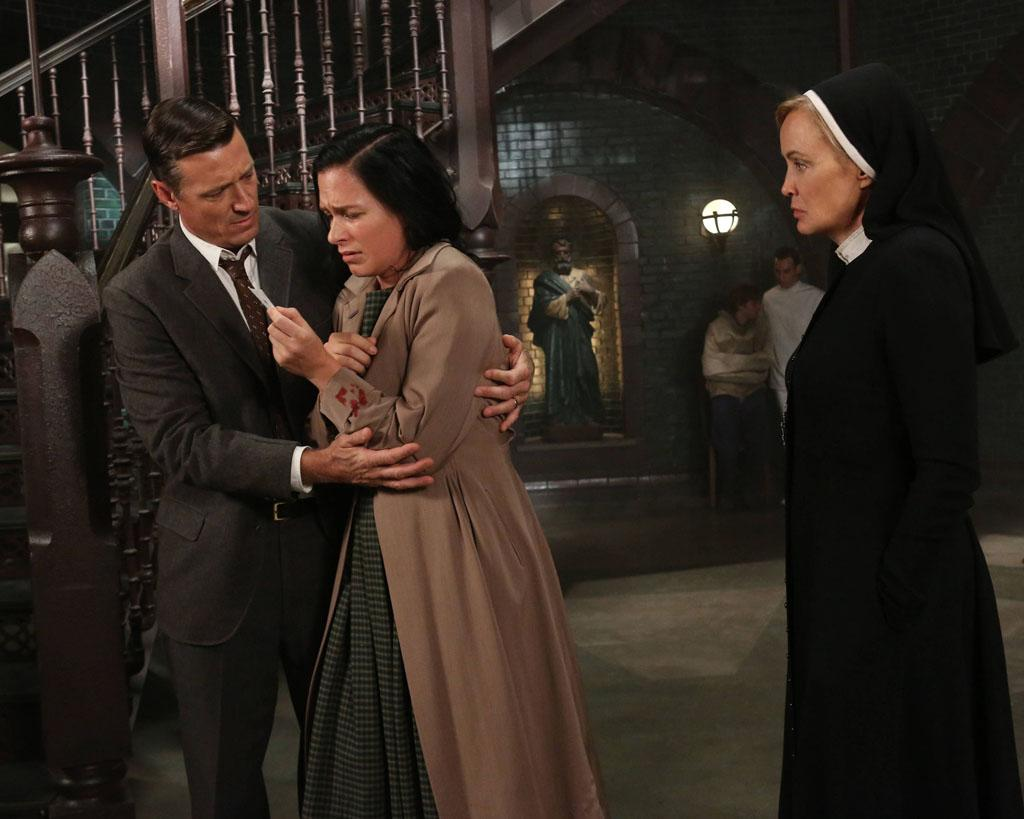 "David Chisum as Jim Brown, Franka Potente as Kassie and Jessica Lange as Sister Jude in the ""American Horror Story: Asylum"" episode, ""I Am Anne Frank, Part 2."""