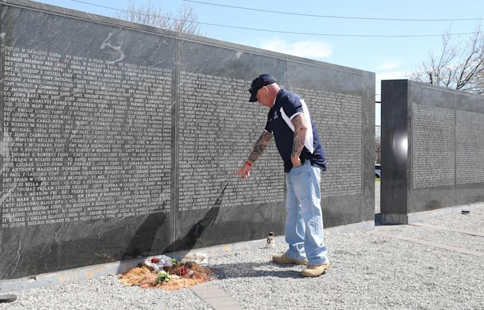 John Feal points out the name of his friend, FDNY F.F. Ray Pfeifer, on the 9/11 Responders Remembered Park in Nesconset, April 6, 2021. Feal, who established the FealGood Foundation and created the park, has become a leading activist in getting the 9/11 James Zadroga Act, the WTC Health Program and the 9/11 Victims Compensation Fund, passed and then renewed and then made permanent.