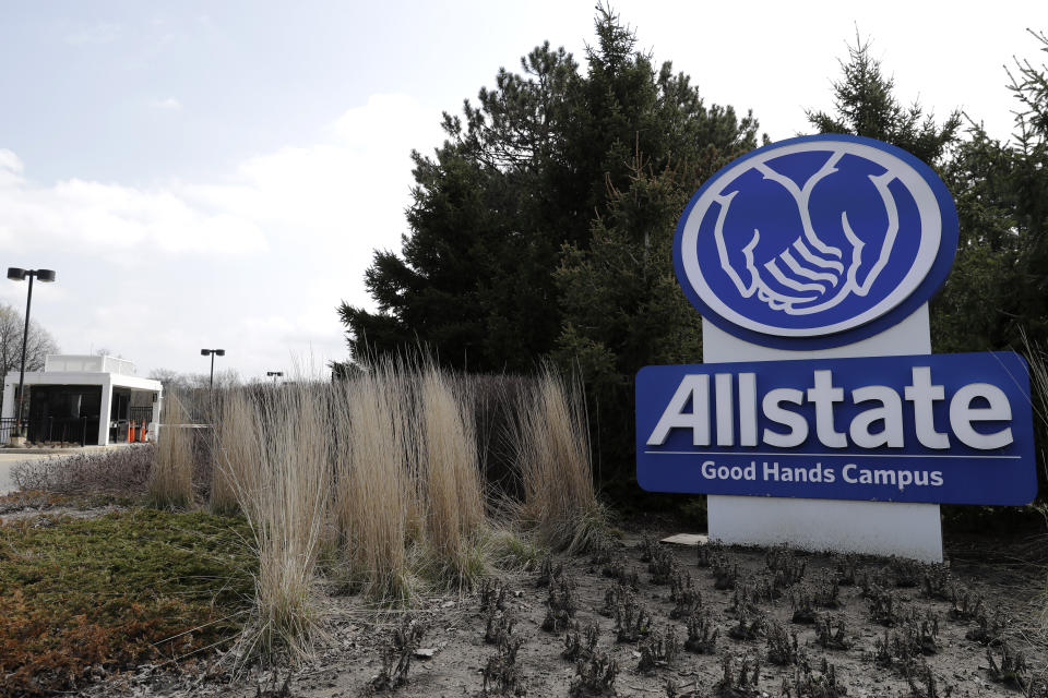 """Allstate Company sign is seen in front of Allstate company in Northbrook, Ill., Tuesday, April 7, 2020. Allstate said there have been fewer vehicle accidents during the COVID-19 pandemic as people stay home more to slow the spread of the virus. The Allstate """"Shelter-in-Place Payback"""" will give more than $600 million in April and May for auto insurance customers. (AP Photo/Nam Y. Huh)"""