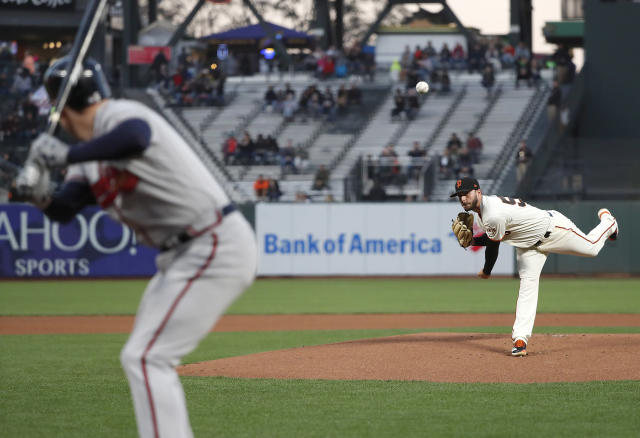 San Francisco Giants starting pitcher Andrew Suarez (59) throws against the Atlanta Braves during the first inning of a baseball game in San Francisco, Tuesday, Sept. 11, 2018. (AP Photo/Tony Avelar)