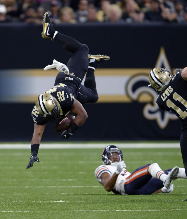 <p>New Orleans Saints running back Mark Ingram (22) goes airborne as he leaps over Chicago Bears cornerback Kyle Fuller (23) in the first half of an NFL football game in New Orleans, Sunday, Oct. 29, 2017. (AP Photo/Bill Feig) </p>