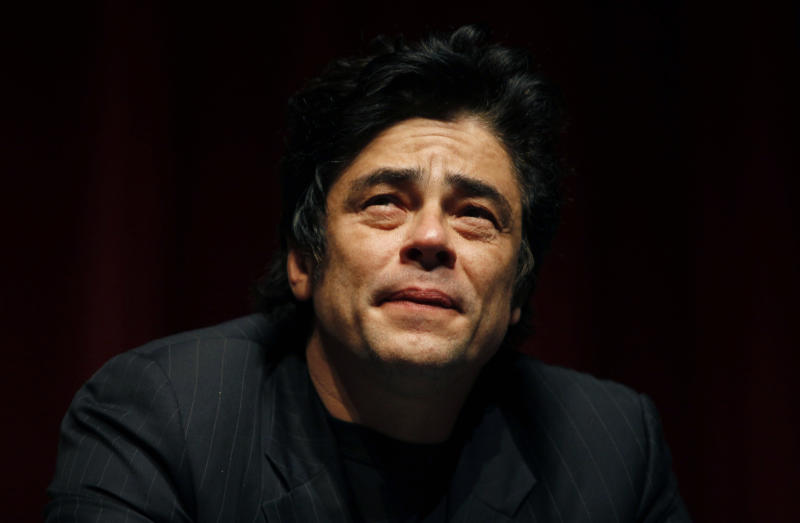 """Puerto Rican actor Benicio Del Toro pauses during a conference with Oliver Stone and students at the University of Puerto Rico in San Juan, Friday, Nov. 30, 2012. Del Toro didn't wait long to collect on a favor that Stone owed him for working extra hours on the set of his most recent movie, """"Savages"""", released this year: a trip to his native Puerto Rico, which Stone hadn't visited since the early 1960s. Both are in the U.S. Caribbean territory to raise money for the Art Museum of Puerto Rico, which is hosting its annual movie festival and will honor Stone's movies. (AP Photo/Ricardo Arduengo)"""