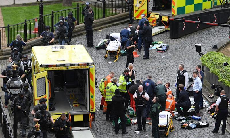 Emergency services at the scene outside the Palace of Westminster, where Pc Keith Palmer was fatally stabbed by Khalid Masood.