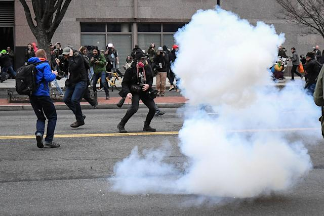Protesters and journalists scramble as stun grenades are deployed by police during a protest in Washington on Inauguration Day.