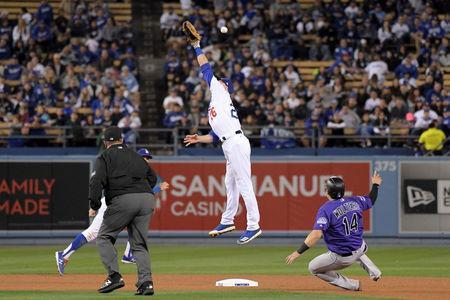 May 21, 2018; Los Angeles, CA, USA;Colorado Rockies catcher Tony Wolters (14) slides into second base for a stolen base after Los Angeles Dodgers second baseman Chase Utley (26) is unable to field a throw in the eighth inning at Dodger Stadium. The Rockies defeated the Dodgers 2-1. Mandatory Credit: Kirby Lee-USA TODAY Sports