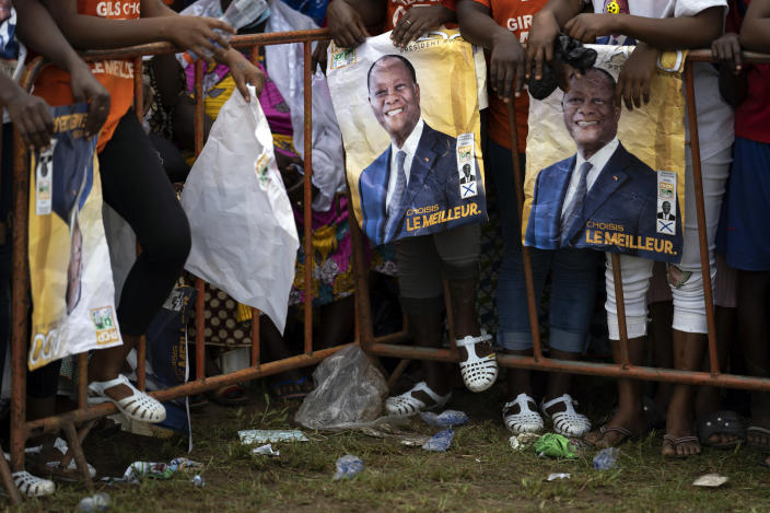 Supporters wait for the arrival of the Ivory Coast President Alassane Ouattara at a rally in Anyama, in the outskirts of Abidjan, Ivory Coast, Wednesday, Oct. 28, 2020. Ouattara, who first came to power after the 2010 disputed election whose aftermath left more than 3,000 people dead, is now seeking a third term in office. The candidate maintains that he can serve a third term because of changes to the country's constitution, though his opponents consider his candidacy illegal. (AP Photo/Leo Correa)