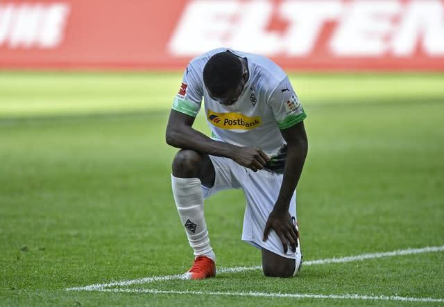 Marcus Thuram takes the knee after scoring for Borussia Monchengladbach at the weekend (Martin Meissner/AP)