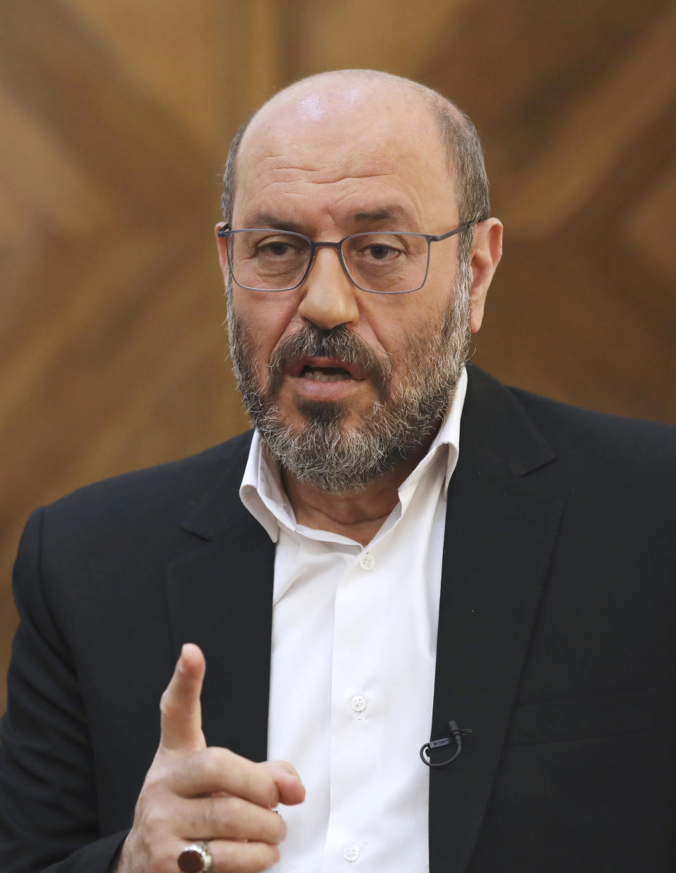 """Gen. Hossein Dehghan, a military advisor to Iran's Supreme Leader Ayatollah Ali Khamenei, speaks during an interview with The Associated Press in Tehran, Iran, Wednesday, Nov. 18, 2020. Dehghan, who is a possible 2021 presidential candidate, warned that any American attack on the Islamic Republic could set off a """"full-fledged war"""" in the Mideast in the waning days of the Trump administration. (AP Photo/Vahid Salemi)"""