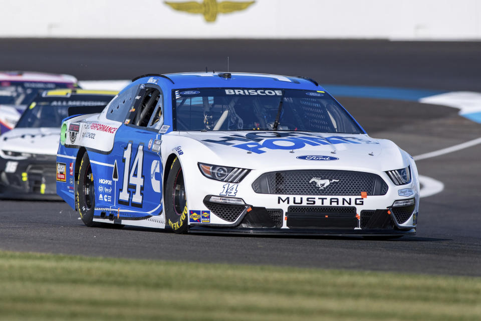 Chase Briscoe (14) during qualifying for a NASCAR Cup Series auto race at Indianapolis Motor Speedway, Sunday, Aug. 15, 2021, in Indianapolis. (AP Photo/Doug McSchooler)