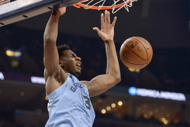 Memphis Grizzlies forward Jaren Jackson Jr. (13) dunks during the second half of the team's NBA basketball game against the Houston Rockets on Tuesday, Jan. 14, 2020, in Memphis, Tenn. (AP Photo/Brandon Dill)