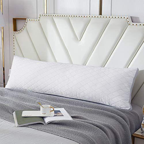 """<p><strong>WhatsBedding</strong></p><p>amazon.com</p><p><strong>$39.99</strong></p><p><a href=""""https://www.amazon.com/dp/B08FSYX8M4?tag=syn-yahoo-20&ascsubtag=%5Bartid%7C2140.g.29490211%5Bsrc%7Cyahoo-us"""" rel=""""nofollow noopener"""" target=""""_blank"""" data-ylk=""""slk:Shop Now"""" class=""""link rapid-noclick-resp"""">Shop Now</a></p><p>Your partner might want to steal this cuddly body pillow, so watch out. It'll support your back, legs, and belly throughout your pregnancy. And who knows? It's so comf, it might earn a permanent spot on your bed.</p><p><strong>Rave Review: </strong>""""I bought it for relief of pregnancy pain and it has been working wonders! I finally fell asleep for more than one hour last night.""""</p>"""
