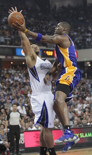 Los Angeles Lakers forward Antawn Jamison, right, drives to the basket against Sacramento Kings forward Chuck Hayes during the first quarter of an NBA basketball game in Sacramento, Calif., Saturday, March 30, 2013. (AP Photo/Rich Pedroncelli)