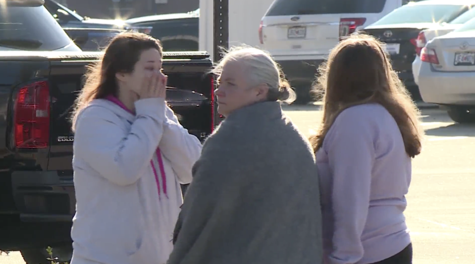 Family and friends of Amethyst Killian, 22, cry outside a crime scene in Missouri.