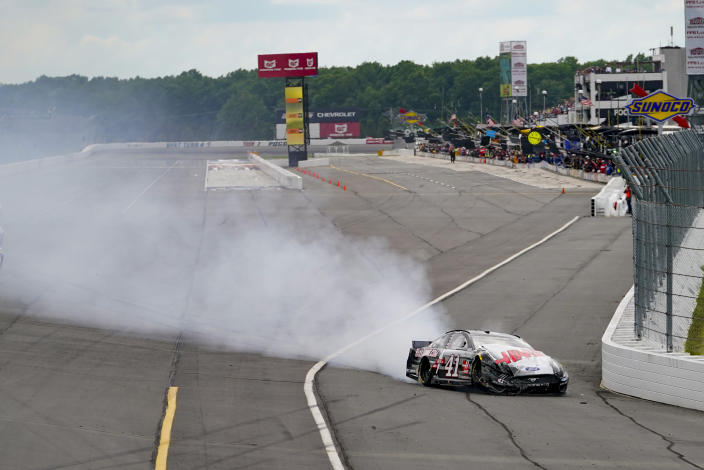 Cole Custer (41) slides across the track after crashing along the front straight during a NASCAR Cup Series auto race at Pocono Raceway, Saturday, June 26, 2021, in Long Pond, Pa. (AP Photo/Matt Slocum)