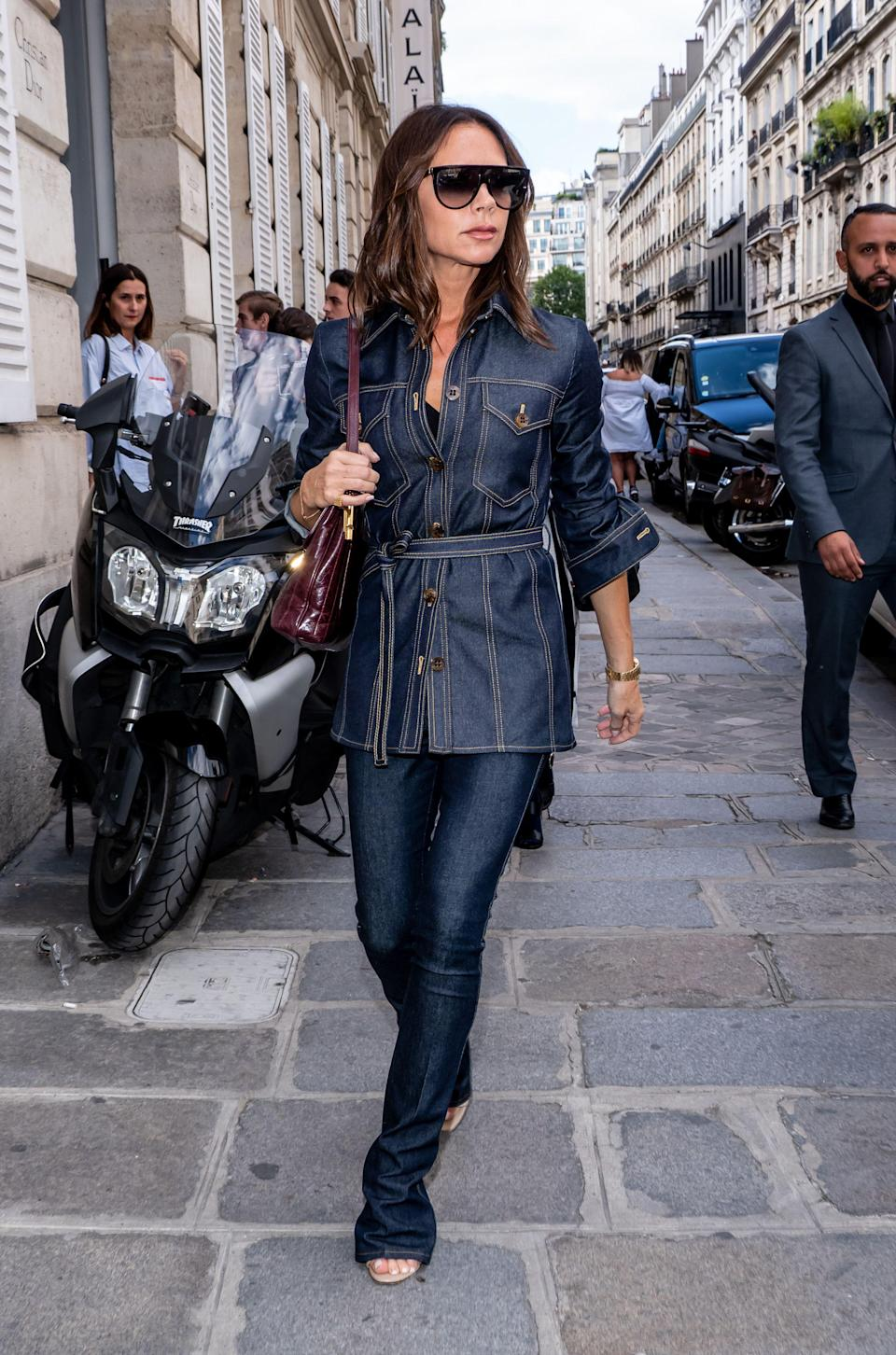 <p>A far cry from her nineties denim-wearing days, Victoria Beckham showed how to bring a French air of chic to the trend out and about in Paris – of course, in her own label. <em>[Photo: Rex]</em> </p>