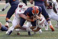 Wisconsin linebacker Noah Burks (41) and linebacker Leo Chenal sack Illinois quarterback Brandon Peters during the first half of an NCAA college football game Saturday, Oct. 9, 2021, in Champaign, Ill. (AP Photo/Charles Rex Arbogast)