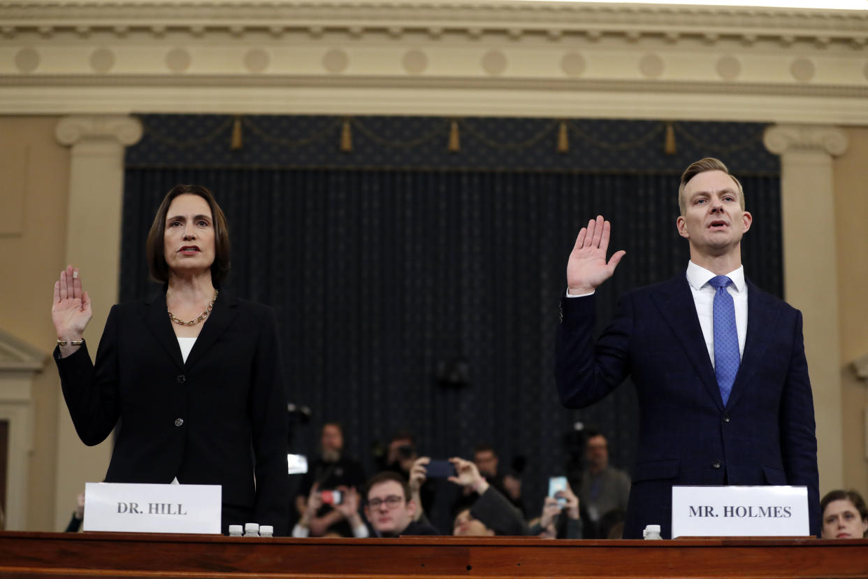Former White House national security aide Fiona Hill, left, and David Holmes, a U.S. diplomat in Ukraine, are sworn in to testify before the House Intelligence Committee on Capitol Hill in Washington, Thursday, Nov. 21, 2019, during a public impeachment hearing of President Donald Trump's efforts to tie U.S. aid for Ukraine to investigations of his political opponents. (Photo: Andrew Harnik/AP)