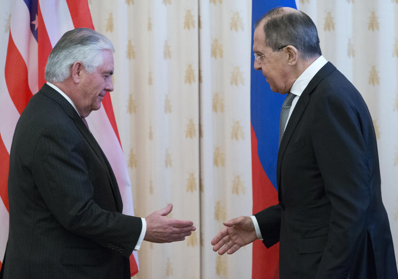 <p>U.S. Secretary of State Rex Tillerson, left, and Russian Foreign Minister Sergey Lavrov shake hands prior to their talks in Moscow, Russia, Wednesday, April 12, 2017. Tillerson's Moscow talks hinge on new US leverage over Syria. (AP Photo/Alexander Zemlianichenko) </p>
