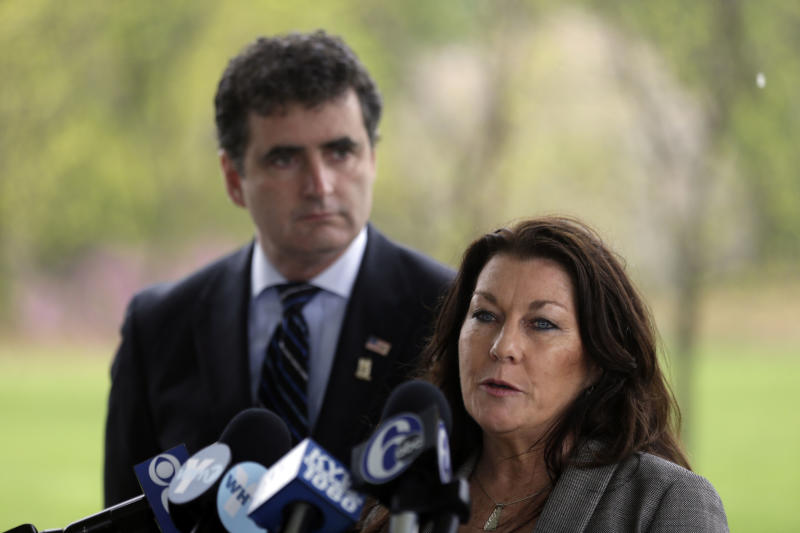 Rep. Mike Fitzpatrick, R-Pa., looks on as Ellen Saracini, whose husband Victor was the captain of United Airlines Flight 175 that crashed into the World Trade Center on Sept. 11, 2001, speaks during a news conference at the at the Garden of Reflection memorial to local victims of the 9/11 terrorist attacks, Monday, April 29, 2013, in Yardley, Pa. Fitzpatrick proposed new legislation aimed at protecting airline passengers and pilots from the kind of terrorist attack upon the nation a dozen years ago. (AP Photo/Matt Rourke)