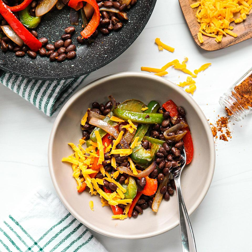 """<p>You can often find presliced and ready-to-cook fresh vegetables in your grocer's produce section. Use these to your advantage to cut down on dinnertime prep. Here, presliced fajita vegetables are sautéed with canned black beans and Southwest seasoning for a quick and easy Tex Mex-inspired meal. Plus, this recipe requires just three ingredients, not including basics like salt, pepper and oil. You can easily take your bowl up a notch by adding some cheese, sour cream or another tasty topping.</p> <p> <a href=""""https://www.eatingwell.com/recipe/7886570/black-bean-fajita-skillet/"""" rel=""""nofollow noopener"""" target=""""_blank"""" data-ylk=""""slk:View recipe"""" class=""""link rapid-noclick-resp""""> View recipe </a></p>"""
