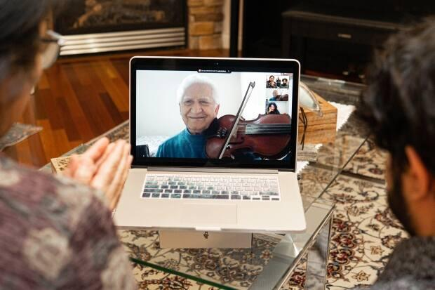 Alavi's father-in-law, Vajihullah Imamverdi, plays a song on the violin for his grandchildren.