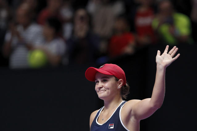 Ashleigh Barty of Australia waves to the spectators after defeating Elina Svitolina of Ukraine in the WTA Finals Tennis Tournament at the Shenzhen Bay Sports Center in Shenzhen, China's Guangdong province, Sunday, Nov. 3, 2019. (AP Photo/Andy Wong)