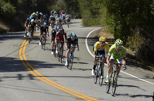 The peloton rides with Bradley Wiggins, second from right, of Great Britain, during the final stage of the Tour of California cycling race, Sunday, May 18, 2014, in Thousand Oaks, Calif. Wiggins won the overall race. (AP Photo/Mark J. Terrill)