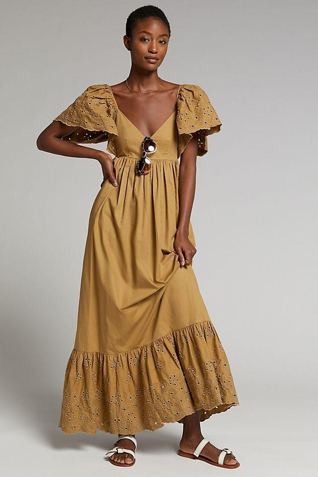 """<p><strong>En Saison</strong></p><p>anthropologie.com</p><p><strong>$138.00</strong></p><p><a href=""""https://go.redirectingat.com?id=74968X1596630&url=https%3A%2F%2Fwww.anthropologie.com%2Fshop%2Fhayley-flounced-maxi-dress&sref=https%3A%2F%2Fwww.womenshealthmag.com%2Flife%2Fg36173394%2Fsummer-wedding-guest-dresses%2F"""" rel=""""nofollow noopener"""" target=""""_blank"""" data-ylk=""""slk:Shop Now"""" class=""""link rapid-noclick-resp"""">Shop Now</a></p><p>Nothing says """"summer wedding"""" like a long, flowy dress. It features pretty eyelet detailing on the sleeves and skirt. Plus, bonus points for pockets!</p>"""