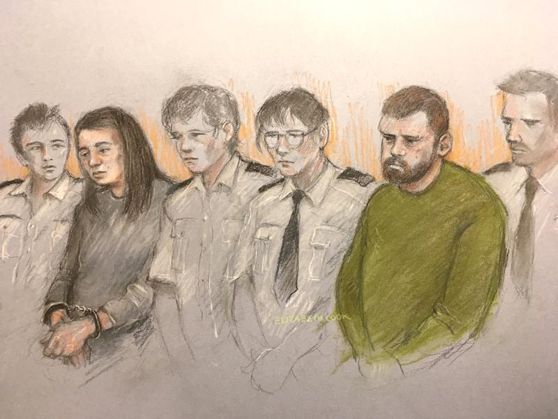 Court artist sketch by Elizabeth Cook of Sarah Barrass, 34, and Brandon Machin, 37, flanked by security staff as they sit in the dock at Sheffield Crown Court, where they are accused of murdering Blake Barrass, 14, and 13-year-old Tristan Barrass following an incident in the Shiregreen area of Sheffield on Friday.