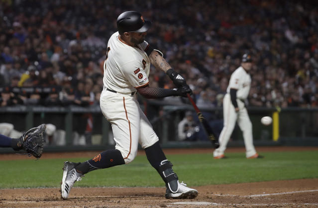 San Francisco Giants' Kevin Pillar hits a grand slam against the San Diego Padres during the fourth inning of a baseball game in San Francisco, Monday, April 8, 2019. (AP Photo/Jeff Chiu)