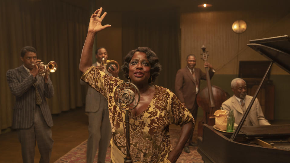 "This image released by Netflix shows Chadwick Boseman, from left, Colman Domingo, Viola Davis, Michael Potts and Glynn Turman in ""Ma Rainey's Black Bottom."" On Friday, Feb. 26, Netflix released a study it commissioned from top academic researchers that shows the streaming giant is outpacing much of the film industry in the inclusivity of its original films and television series. (David Lee/Netflix via AP)"