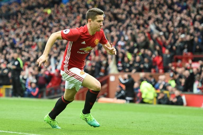Manchester United's midfielder Ander Herrera runs to the corner to celebrate scoring their second goal during the English Premier League football match between Manchester United and Chelsea on April 16, 2017