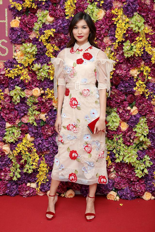 <p>Gemma Chan gave the fashion world one last glimpse of summer florals in a sheer midi dress at the UK premiere of 'Crazy Rich Asians' on 3 September. <em>[Photo: Freuds]</em> </p>