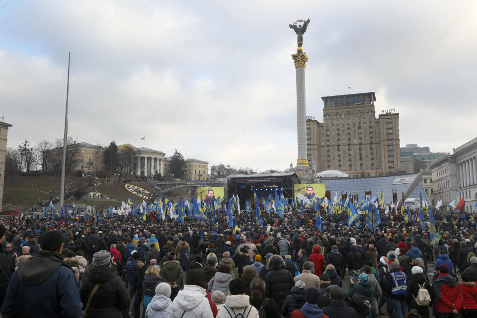 Activists attend a rally in central Kyiv, Ukraine, Sunday, Dec. 8, 2019. Several thousand people rallied Sunday in the Ukrainian capital of Kyiv to demand that the president defend the country's interests in this week's summit with Russia, Germany and France on ending the war in eastern Ukraine. (AP Photo/Efrem Lukatsky)