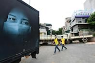 The pandemic has hit Vietnam's textile industry and is threatening global coffee supplies (AFP/NHAC NGUYEN)