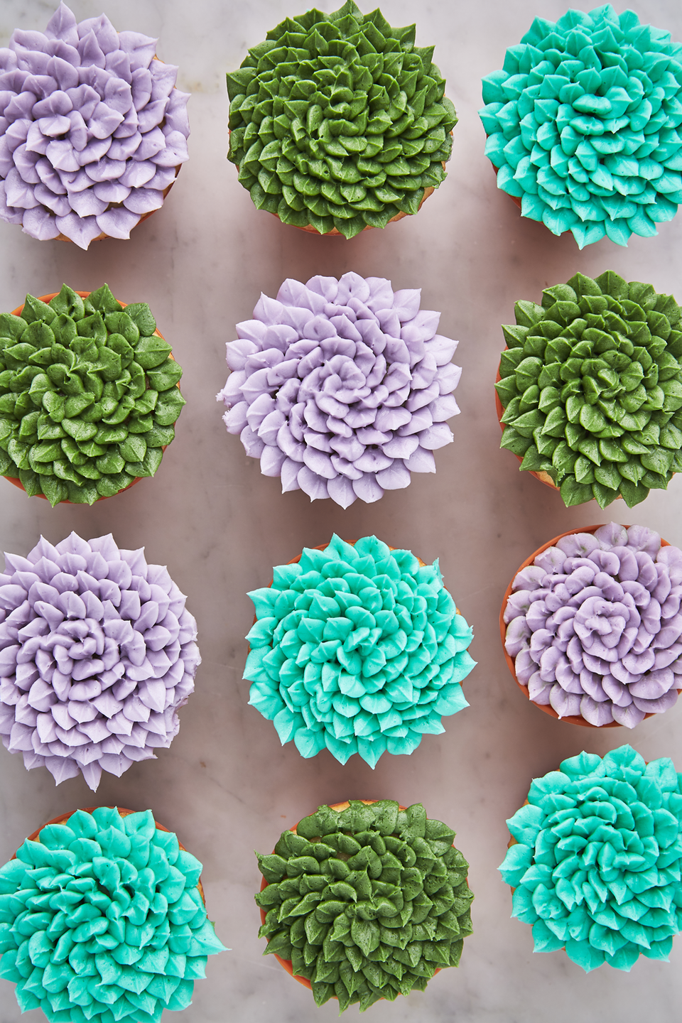 """<p>Plant moms will freak over these gorgeous cupcakes.</p><p>Get the recipe from <a href=""""https://www.delish.com/cooking/recipe-ideas/a19802923/succulent-cupcakes-recipe/"""" rel=""""nofollow noopener"""" target=""""_blank"""" data-ylk=""""slk:Delish"""" class=""""link rapid-noclick-resp"""">Delish</a>.</p>"""