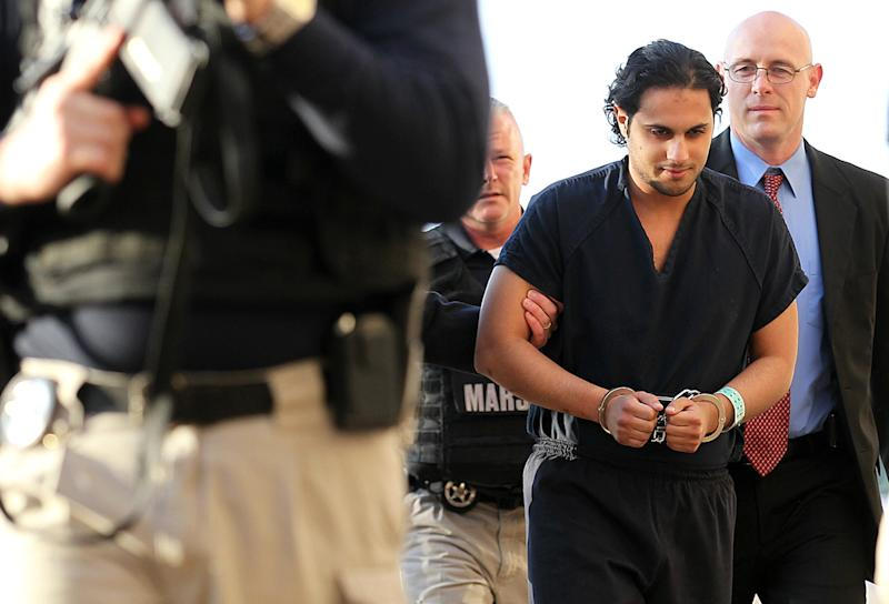 FILE - In this Feb. 25, 2011, file photo, Khalid Ali-M Aldawsari is escorted to court in Lubbock, Texas. A jury was selected Thursday, June 21, 2012, for the trial of the Saudi man who is accused of gathering bomb components with the intention of targeting sites across the United States, including the home of former President George W. Bush.(AP Photo/Lubbock Avalanche-Journal, Zach Long, File)